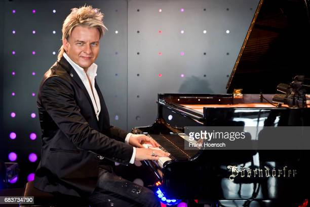 Hungarian pianist Balazs Havasi performs live on stage during a showcase at the MercedesBenz Arena on May 16 2017 in Berlin Germany