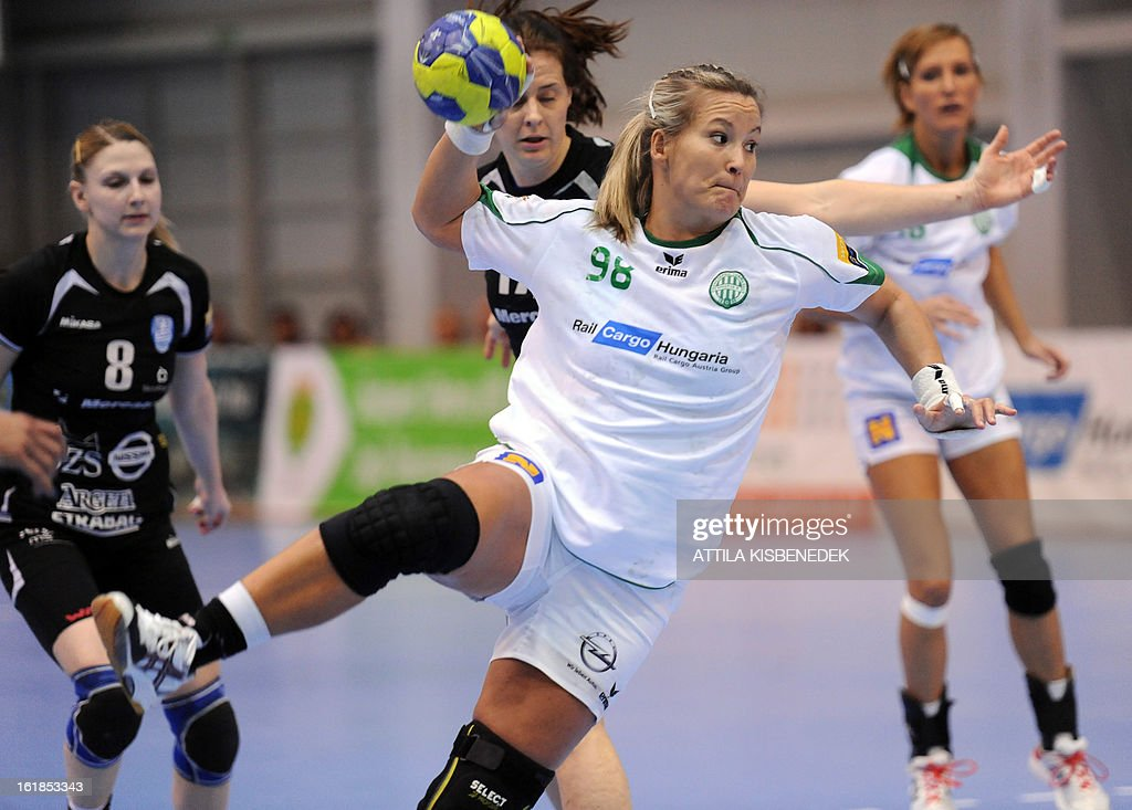 Hungarian Piroska Szamoransky (2nd R) of FTC Rail Cargo Hungaria scores a goal against Slovenian Linnea Torstensson (2nd L) and Tamara Mavsar (L) of RK Krim Mercator in the local sports hall of Dabas, Hungary, on February 17, 2013 during their EHF Women's Champions League handball match.
