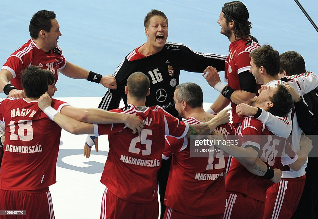 Hungarian players celebrate at the end of the 23rd Men's Handball World Championships round of 16 match Hungary vs Poland at the Palau Sant Jordi in Barcelona on January 21, 2013. Hungary won 27-19.
