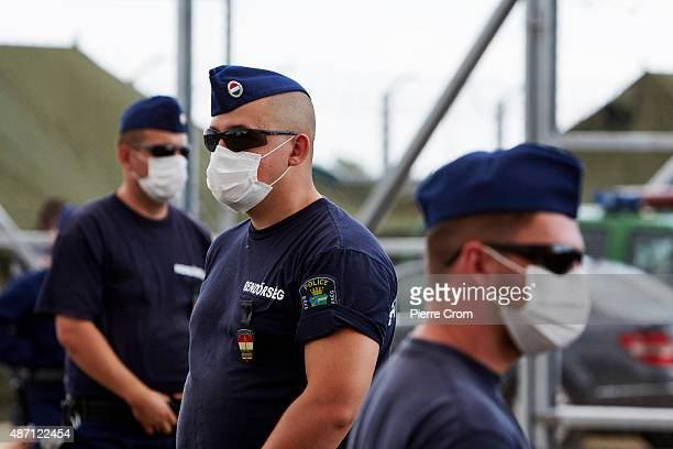 Hungarian police assemble migrants who have crosssed the border from Serbia as they journey into Europe on September 6 2015 in Roszke Hungary...