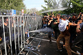 Hungarian police use pepper spray against mingrants at the Horgos border near the town of Kanjiza after Hungarian authorities closed their border on...