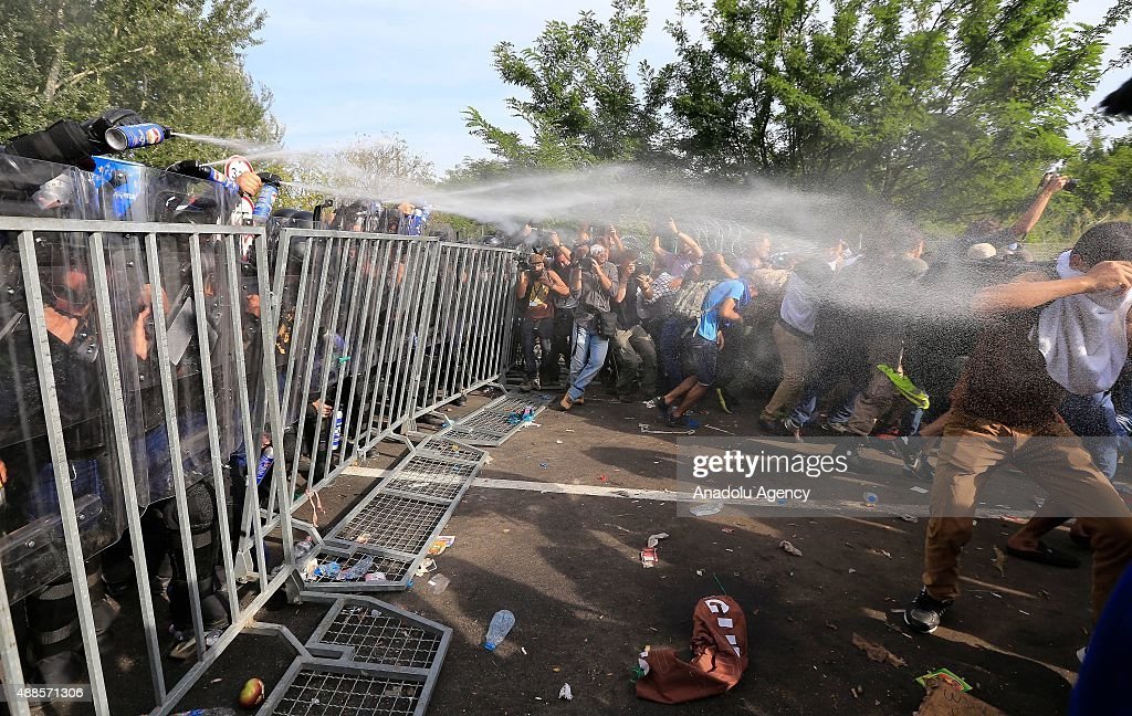 Hungarian police use pepper spray against refugees at the Horgos border near the town of Kanjiza after Hungarian authorities closed their border in...