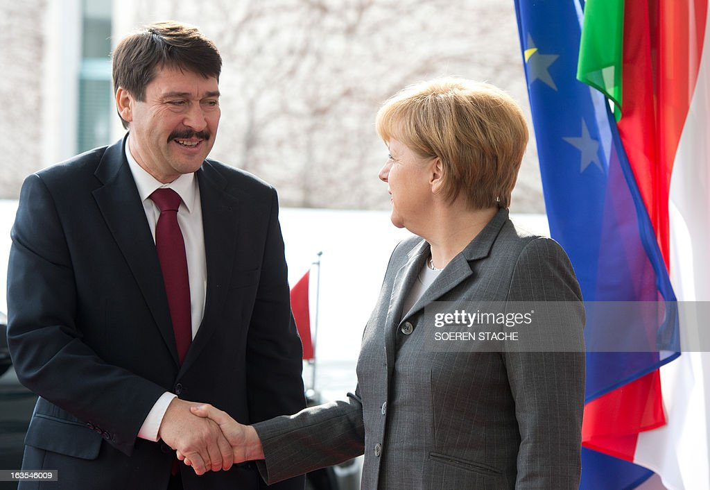 Hungarian President Janos Ader (L) and German Chancellor Angela Merkel (R) shake hands as they meet at the chancellery in Berlin, Germany on March 12, 2013. This is the second day of President Ader's 4-day-visit to Germany. OUT