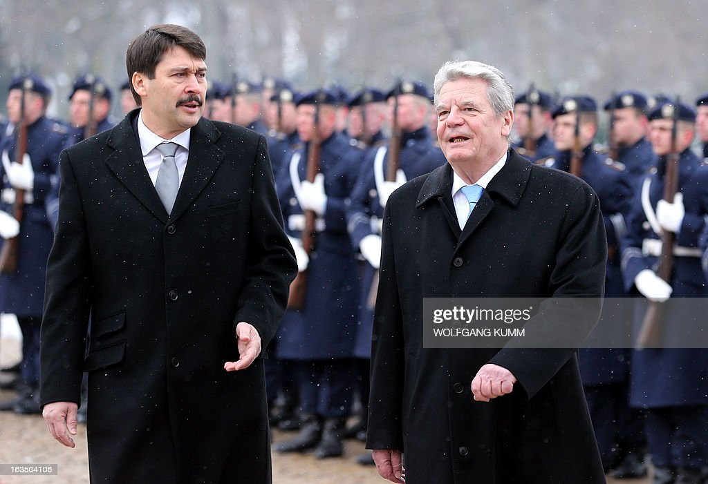 Hungarian President Janos Ader (L) and German President Joachim Gauck (R) review a guard of honour at the presidential Bellevue palace in Berlin, Germany on March 11, 2013. President Ader arrived for an official state visit of several days. OUT