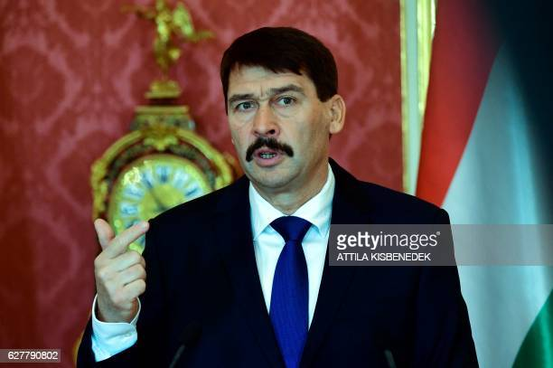 Hungarian President Janos Ader answers to a journalist's question in the Maria Theresia hall of the presidential palace in Budapest on December 5...
