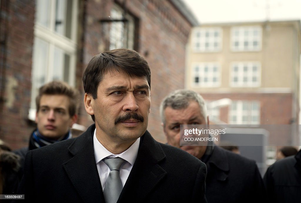 Hungarian President Janos Ader arrives at the former East German secret police (STASI) prison in Hohenschoenhausen, Berlin on March 11, 2013 during his state visit to Germany . The prison is a memorial site since 1994.
