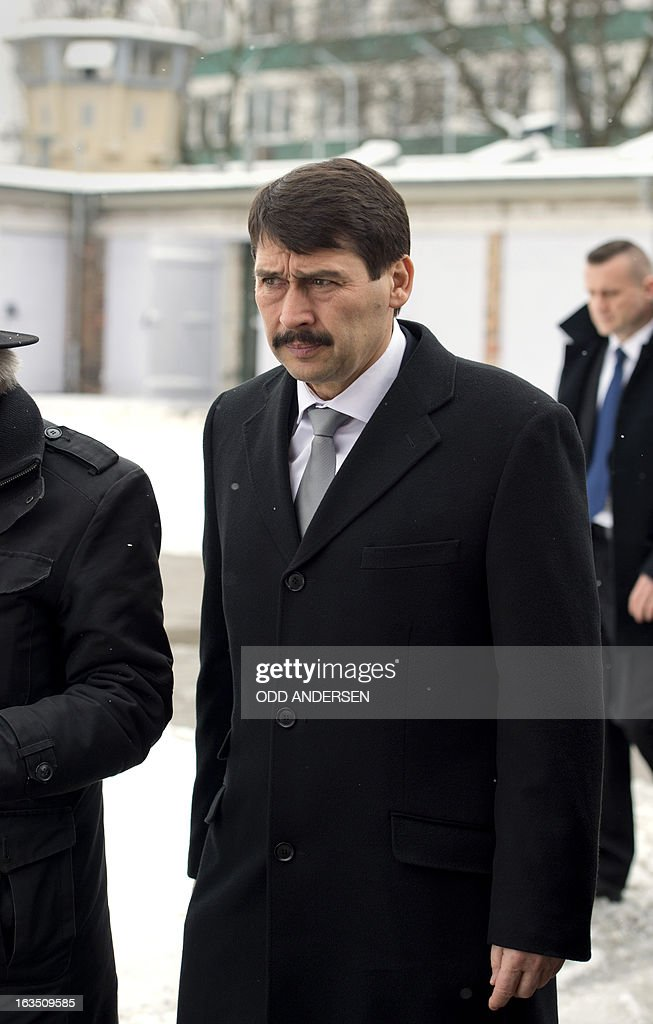 Hungarian President Janos Ader arrives at the former East German secret police (STASI) prison in Hohenschoenhausen, Berlin on March 11, 2013, during his state visit to Germany . The prison is a memorial site since 1994.