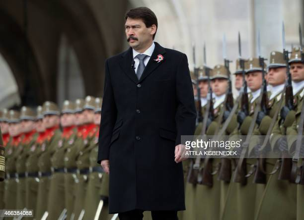 Hungarian President Janos Ader inspects the honour guard in front of the parliament building of Budapest on March 15 2015 during a flaghoisting...