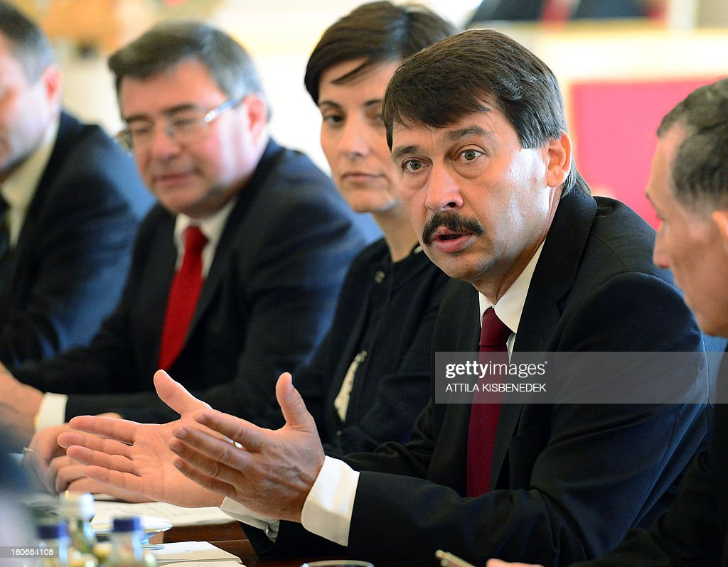 Hungarian President Janos Ader (C) talks to his Vietnamese counterpart during a plenary session at the presidental palace in Budapest on September 16, 2013. Vietnamese President Truong Tan Sang arrived yesterday for his two-day official visit to Hungary.