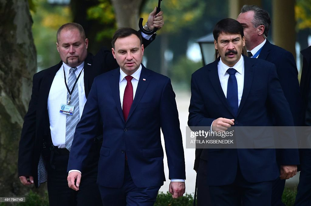 Hungarian President Janos Ader (R) welcomes his Polish counterpart Andrzej Duda for talks with Presidents of the Visegrad (V4) countries in Balatonfured on October 8, 2015.