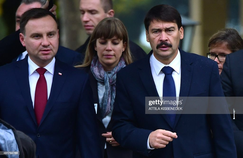 Hungarian President Janos Ader (R) welcomes his Polish counterpart Andrzej Duda (L) for talks with Presidents of the Visegrad (V4) countries in Balatonfured on October 8, 2015.