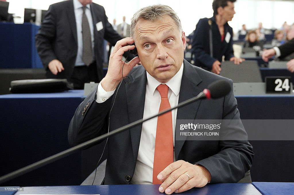 Hungarian Prime Minister Viktor Orban adjusts headphones during a debate on the situation of fundamental rights in Hungary on July 2, 2013 at the European Parliament in Strasbourg, eastern France. AFP PHOTO/FREDERICK FLORIN