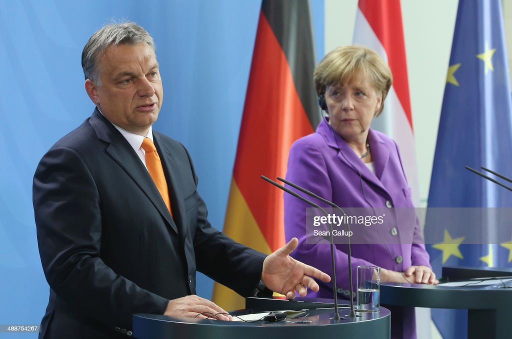 Hungarian Prime Minister <a gi-track='captionPersonalityLinkClicked' href=/galleries/search?phrase=Viktor+Orban&family=editorial&specificpeople=4685765 ng-click='$event.stopPropagation()'>Viktor Orban</a> (L) and German Chancellor <a gi-track='captionPersonalityLinkClicked' href=/galleries/search?phrase=Angela+Merkel&family=editorial&specificpeople=202161 ng-click='$event.stopPropagation()'>Angela Merkel</a> speak to the media prior to talks at the Chancellery on May 8, 2014 in Berlin, Germany. Orban, whose policies have drawn widespread criticism from other European Union member states as undemocratic and right-wing, is on his first visit to Germany since he was recently re-elected.