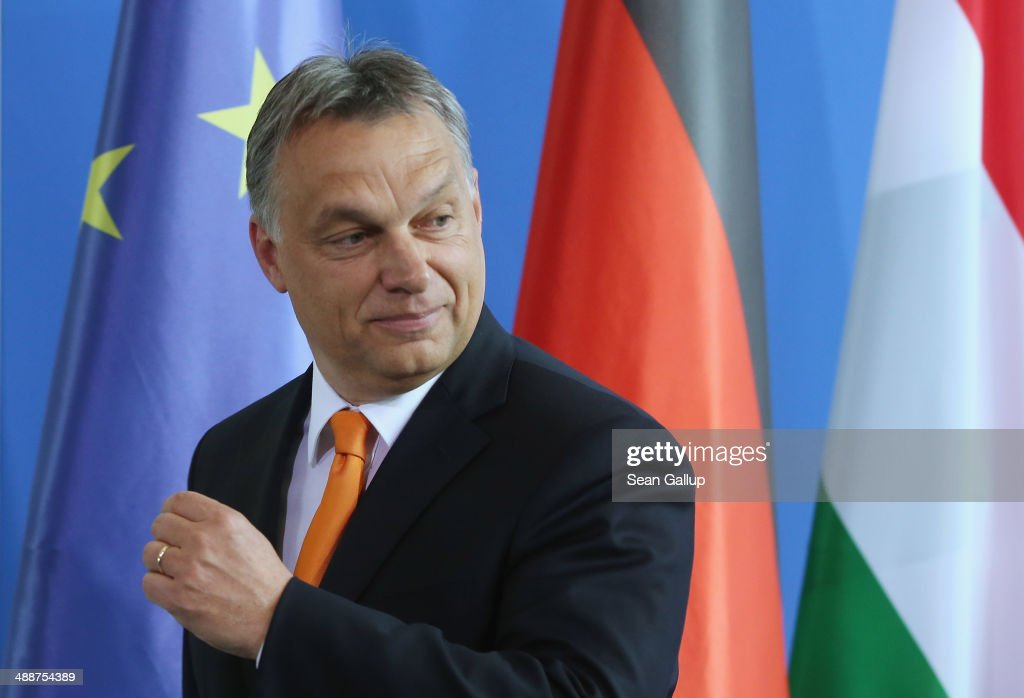 Hungarian Prime Minister <a gi-track='captionPersonalityLinkClicked' href=/galleries/search?phrase=Viktor+Orban&family=editorial&specificpeople=4685765 ng-click='$event.stopPropagation()'>Viktor Orban</a> and German Chancellor Angela Merkel (not pictured) depart after speaking to the media prior to talks at the Chancellery on May 8, 2014 in Berlin, Germany. Orban, whose policies have drawn widespread criticism from other European Union member states as undemocratic and right-wing, is on his first visit to Germany since he was recently re-elected.
