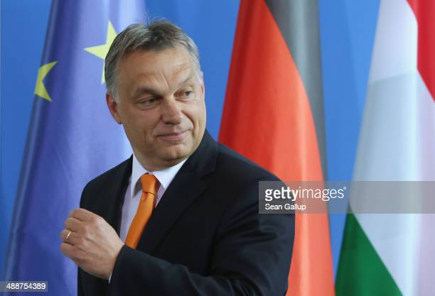 Hungarian Prime Minister Viktor Orban and German Chancellor Angela Merkel depart after speaking to the media prior to talks at the Chancellery on May...