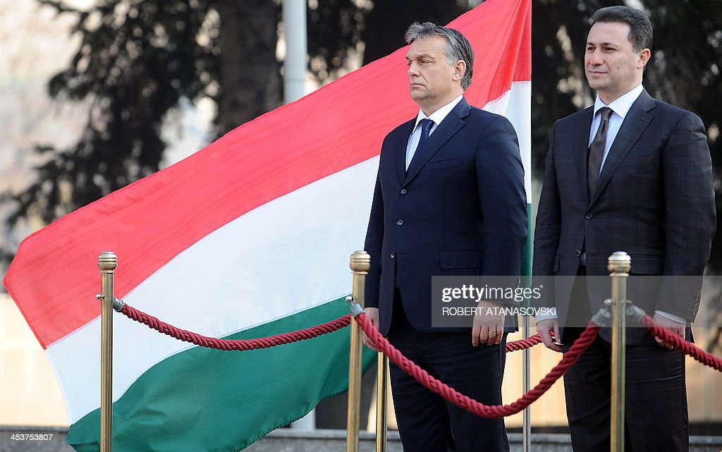 Hungarian Prime Minister Viktor Orban (L) and his Macedonian counterpart Nikola Gruevski listen to their national anthems during a welcoming ceremony ahead of their meeting in Skopje on December 5, 2013.