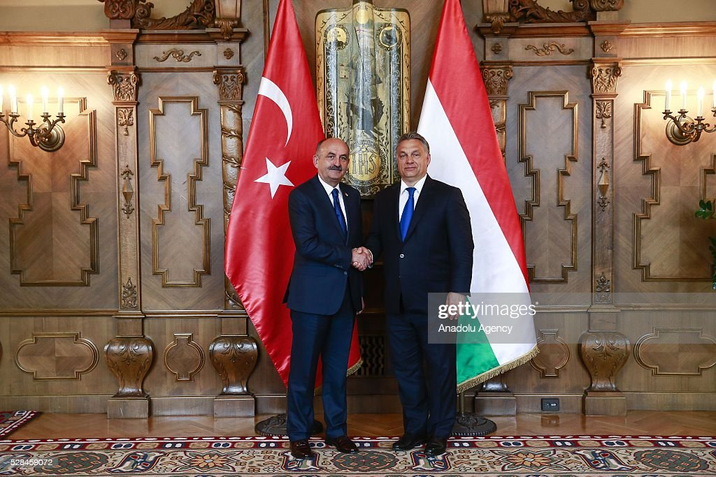 Hungarian Prime Minister Viktor Orban (R) and Turkish Health Minister Mehmet Muezzinoglu (L) shake hands in Budapest, Hungary on May 2, 2016.
