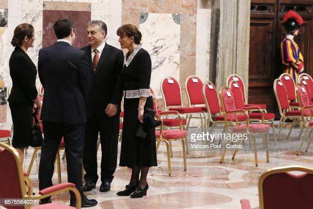 Hungarian Prime Minister Viktor Orban and wife Levai Aniko greet former Greek Prime Minister Alexis Tsipras during a meeting between Pope Francis...