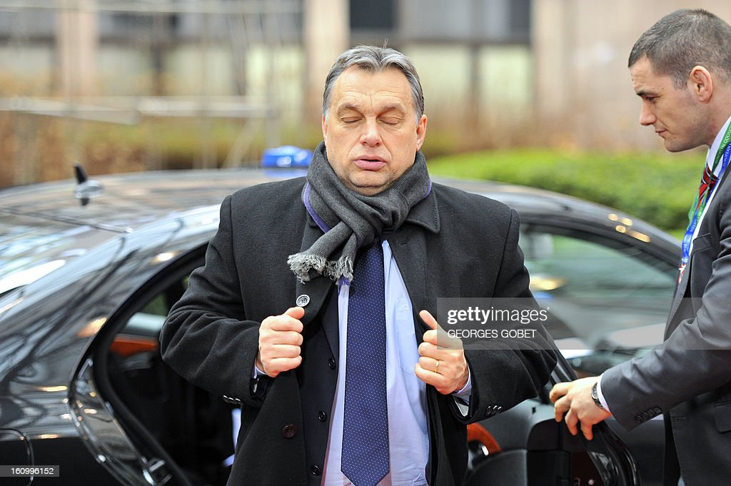 Hungarian Prime Minister Viktor Orban (L) arrives at the EU Headquarters on February 8, 2013 in Brussels, on the last day of a two-day European Union leaders summit. As marathon talks entered an 18th hour EU leaders looked ready on Friday to cut the bloc's budget for the first time in its six-decade history, with a tentative agreement to trim spending by three percent in absolute terms over the rest of the decade, diplomats said.
