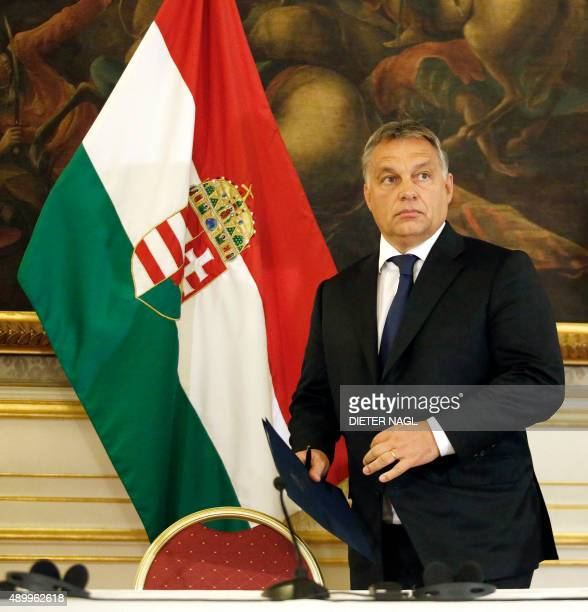 Hungarian Prime minister Viktor Orban arrives for a press conference at the Hungarian Embassy on September 25 2015 in Vienna Hungary announced it had...