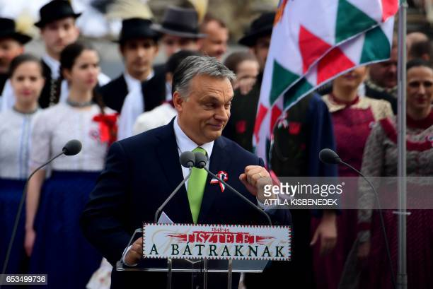 Hungarian Prime Minister Viktor Orban arrives on the podium prior to his speech in front of the National Museum of Budapest on March 15 2017 during...