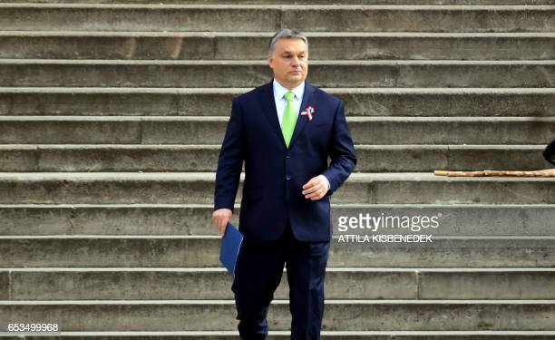 Hungarian Prime Minister Viktor Orban arrives on the podium prior to his speech in front of the National Museum of Budapest on March 15 during the...