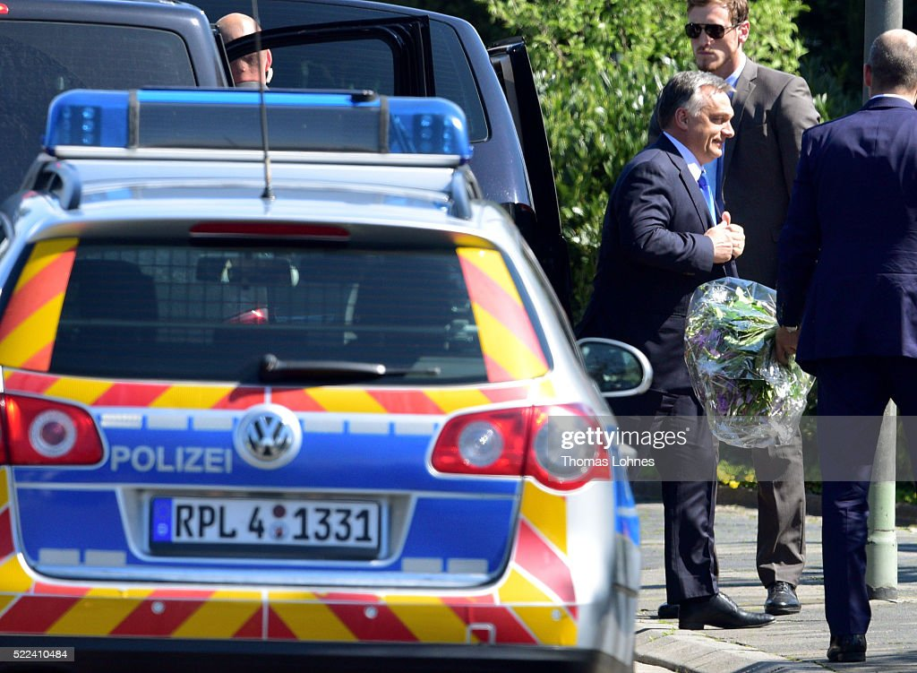 Hungarian Prime Minister <a gi-track='captionPersonalityLinkClicked' href=/galleries/search?phrase=Viktor+Orban&family=editorial&specificpeople=4685765 ng-click='$event.stopPropagation()'>Viktor Orban</a> (C) arrives to visit former German Chancellor Helmut Kohl at Kohl's villa in Oggersheim on April 19, 2016 in Ludwigshafen, Germany. The two men have a long-standing relationship based on conservative politics and going back to the late 1990s when Kohl stepped down as Chancellor and Orban became Hungarian prime minister. Many in Germany are critical of the meeting, saying that Orban's anti-European, right-wing populist policies run in direct contrast to the pro-Europe policies once pursued by Kohl.