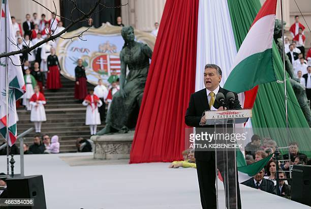 Hungarian Prime Minister Viktor Orban delivers a speech in front of the National Museum of Budapest on March 15 2015 during the official...