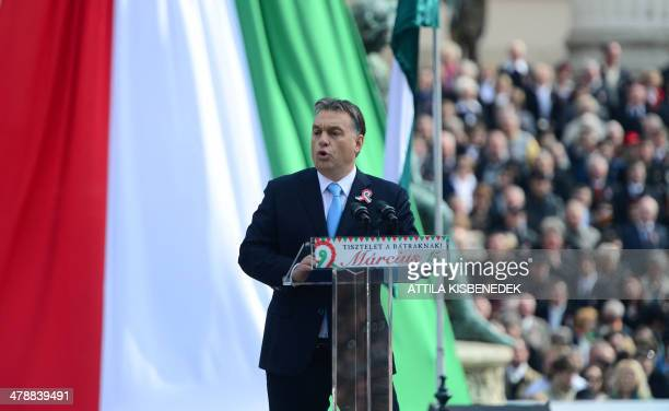 Hungarian Prime Minister Viktor Orban delivers a speech in front of the National Museum of Budapest on March 15 2014 during the official...