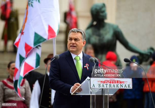 Hungarian Prime Minister Viktor Orban delivers a speech in front of the National Museum of Budapest on March 15 2017 during the official...