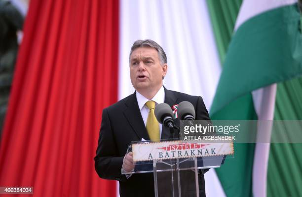 Hungarian Prime Minister Viktor Orban delivers his speech in front of the National Museum of Budapest on March 15 2015 during the official...