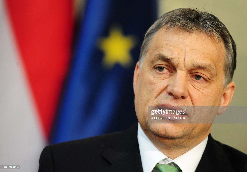 Hungarian Prime Minister Viktor Orban gives a joint press conference with the President of the European Council (unseen) at the delegation hall of the parliament building in Budapest on February 27, 2013. The President of the European Council Herman van Rompuy is on a one-day working visit to Hungary. AFP PHOTO / ATTILA KISBENEDEK