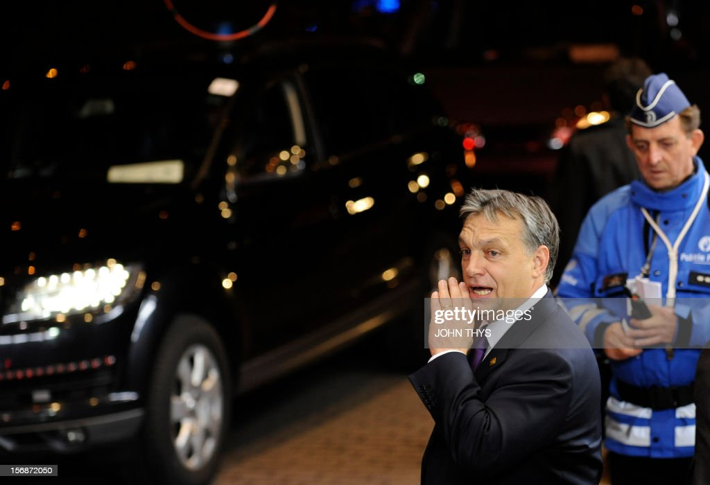 Hungarian Prime Minister Viktor Orban leaves the EU Headquarters on November 23, 2012 in Brussels, during a two-day European Union leaders summit called to agree a hotly-contested trillion-euro budget through 2020. European Union officials were scrambling to find an all but impossible compromise on the 2014-2020 budget that could successfully move richer nations looking for cutbacks closer to poorer ones who look to Brussels to prop up hard-hit industries and regions. AFP PHOTO / JOHN THY