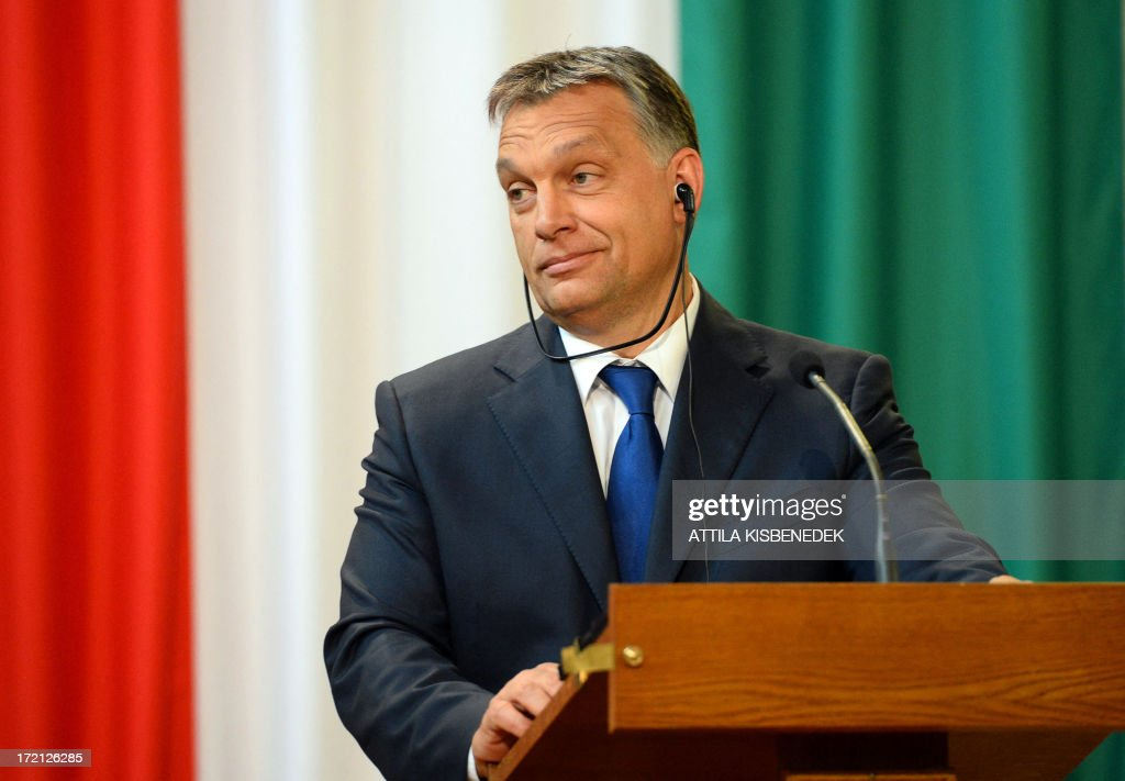 Hungarian Prime Minister Viktor Orban listens to a statement of his Slovakian counterpart Robert Fico (not pictured) in Delegation Hall of the parliament building in central Budapest on July 2, 2013 during their joint press conference. Orban meets with Fico for his one-day working visit.