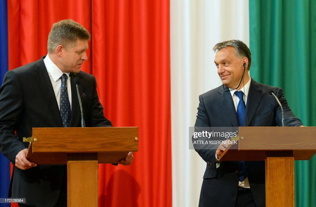 Hungarian Prime Minister Viktor Orban (R) listens to a statement of his Slovakian counterpart Robert Fico (R) in Delegation Hall of the parliament building in central Budapest on July 2, 2013 during their joint press conference. Orban meets with Fico for his one-day working visit.