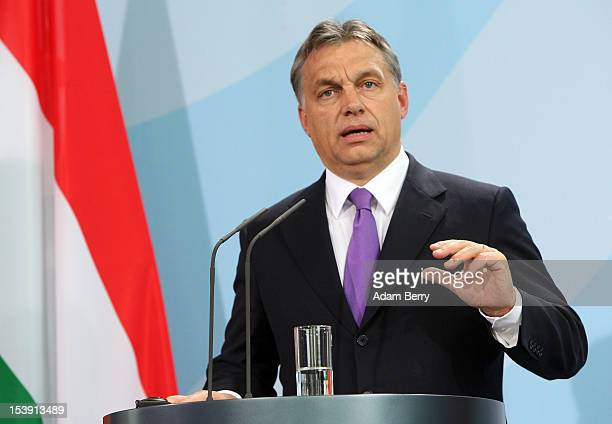 Hungarian Prime Minister Viktor Orban speaks at a news conference in the German Federal Chancellory on October 11 2012 in Berlin Germany Orban and...