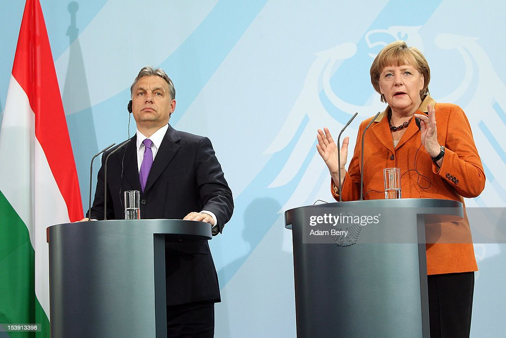 Hungarian Prime Minister <a gi-track='captionPersonalityLinkClicked' href=/galleries/search?phrase=Viktor+Orban&family=editorial&specificpeople=4685765 ng-click='$event.stopPropagation()'>Viktor Orban</a> (L) speaks at a news conference with German Chancellor <a gi-track='captionPersonalityLinkClicked' href=/galleries/search?phrase=Angela+Merkel&family=editorial&specificpeople=202161 ng-click='$event.stopPropagation()'>Angela Merkel</a> in the German Federal Chancellery on October 11, 2012 in Berlin, Germany. Orban and Merkel discussed Hungary's potential adoption of the European common currency.