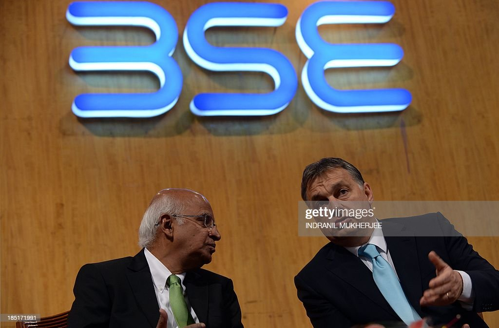 Hungarian Prime Minister Viktor Orban (R) speaks to BSE Chairman S. Ramadorai during a visit to the Bombay Stock Exchange (BSE) in Mumbai on October 18, 2013. Orban is in India for a four-day state visit.