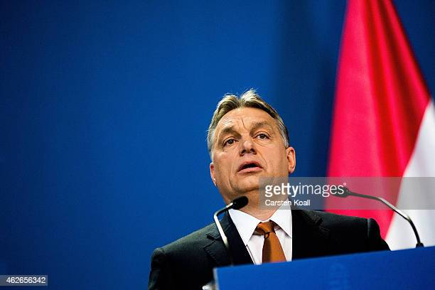 Hungarian Prime Minister Viktor Orban speaks to the media during a press conference with German Chancellor Angela Merkel following talks on February...