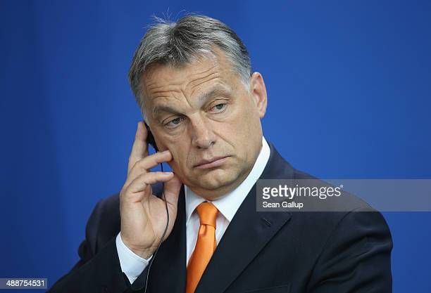 Hungarian Prime Minister Viktor Orban speaks to the media with German Chancellor Angela Merkel prior to talks at the Chancellery on May 8 2014 in...