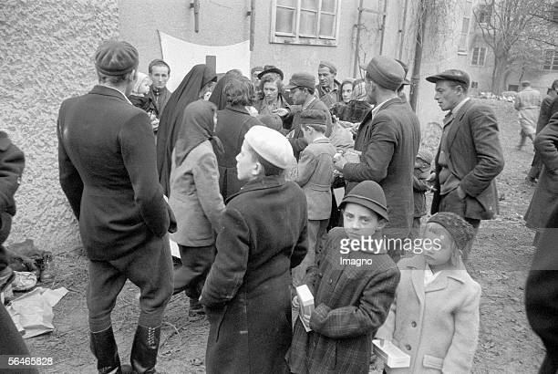 Hungarian Revolution Hungarian refugees in a refugee camp Red Cross distributes aid supplies Austria Photography 1956 [Ungarische Revolution...