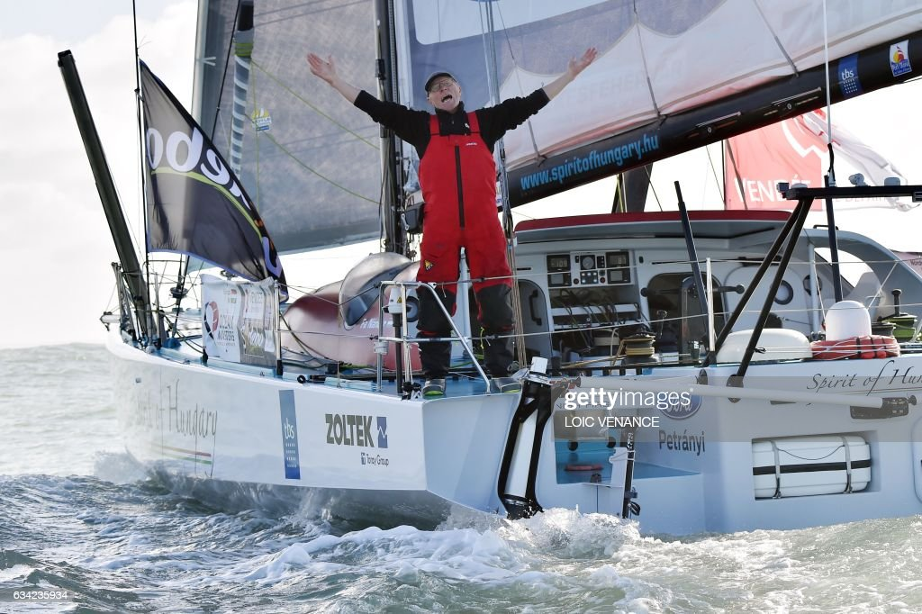 Hungarian skipper Nandor Fa celebrates as he crosses the finish line in Les Sables-d'Olonne, western France, on February 8, 2017, to place 8th in the Vendee Globe solo around-the-world sailing race. /