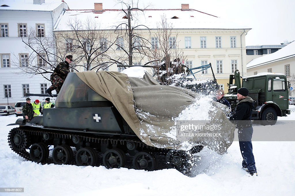 Hungarian soldiers prepare to transport a Hungarian made Nimrod armored car of the 2nd world war into the Military museum of Budapest, 1st district on January 14, 2013.