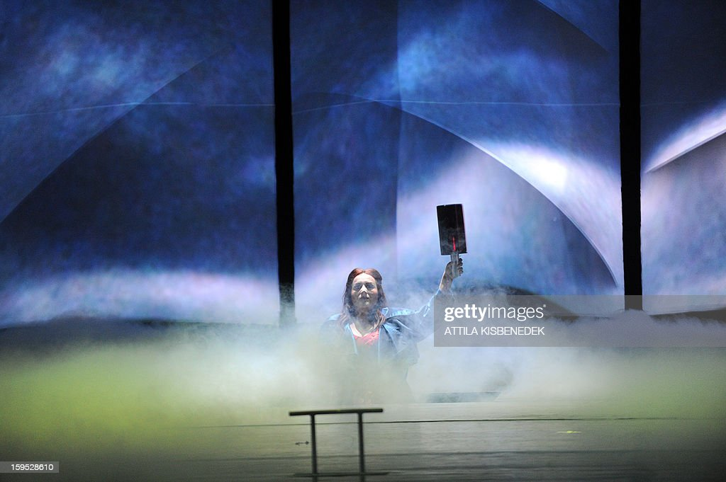 Hungarian soprano Szilvia Ralik of the Hungarian State Oper sings on stage in Budapest, on January 15, 2013 during their rehearsal of a premiere for 'The Flying Dutchman' of the German composer Richard Wagner, directed by Hungarian Janos Szikora. The premiere will take place on January 19, 2013.