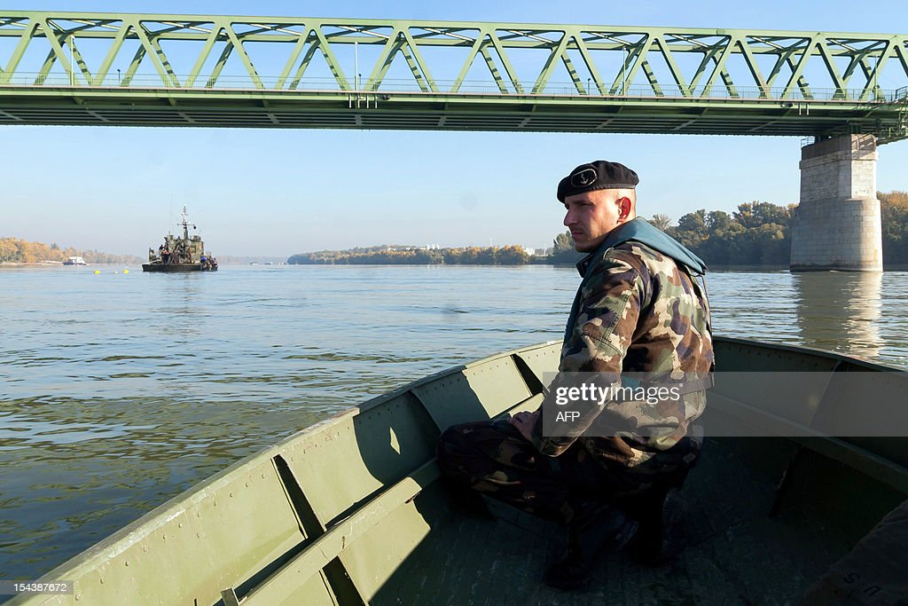 A Hungarian specialist soldier watches the river Danube in Budapest, on October 19, 2012. 8,000 people were evacuated after the discovery of a 500-kilo (1,100-pound) unexploded bomb dating from World War II close to a railway bridge over the river Danube in Budapest .