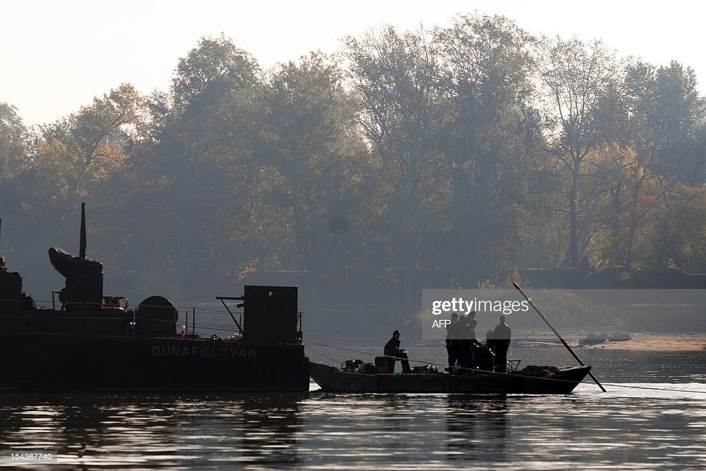 Hungarian specialist soldiers prepare to dive to a bomb in the river Danube in Budapest, on October 19, 2012. 8,000 people were evacuated after the discovery of a 500-kilo (1,100-pound) unexploded bomb dating from World War II close to a railway bridge over the river Danube in Budapest .