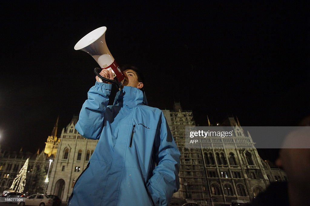 A Hungarian student speaks through a megaphone as students demonstrate against the education fee in Budapest, Hungary on December 12, 2012. University students held demonstrations across Hungary to protest higher education reforms including tuition fees approved last week by parliament.