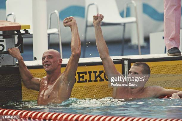 Hungarian swimmer Tamas Darnyi pictured on right celebrating after competing to finish in first place to win the gold medal with bronze medal winning...