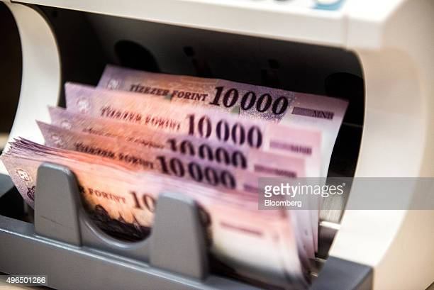 Hungarian tenthousand Forint banknotes run through a money counting machine at a branch inside the FHB Commercial Bank Ltd also known as FHB...