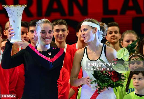 Hungarian Timea Babos celebrates her victory over Czech Lucie Safarova with her trophy after the final of the WTA Hungarian Open Ladies' tennis...